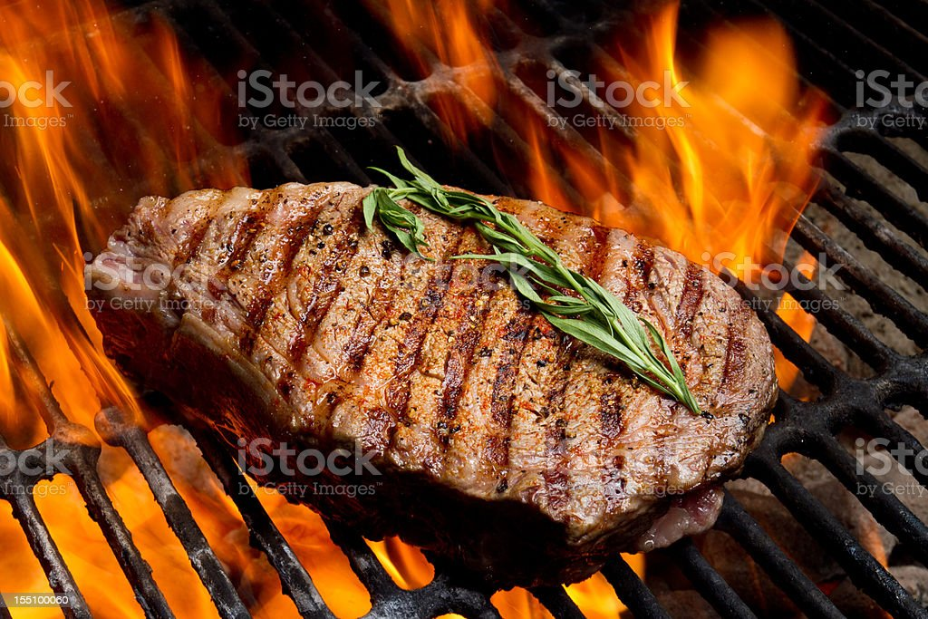 Ribeye Steak on Grill with Fire stock photo