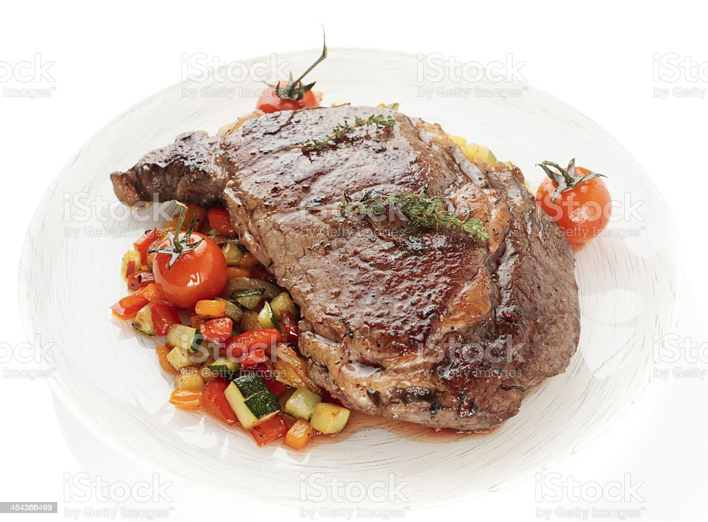 Ribeye steak with stir fried vegetables isolated on white royalty-free stock photo