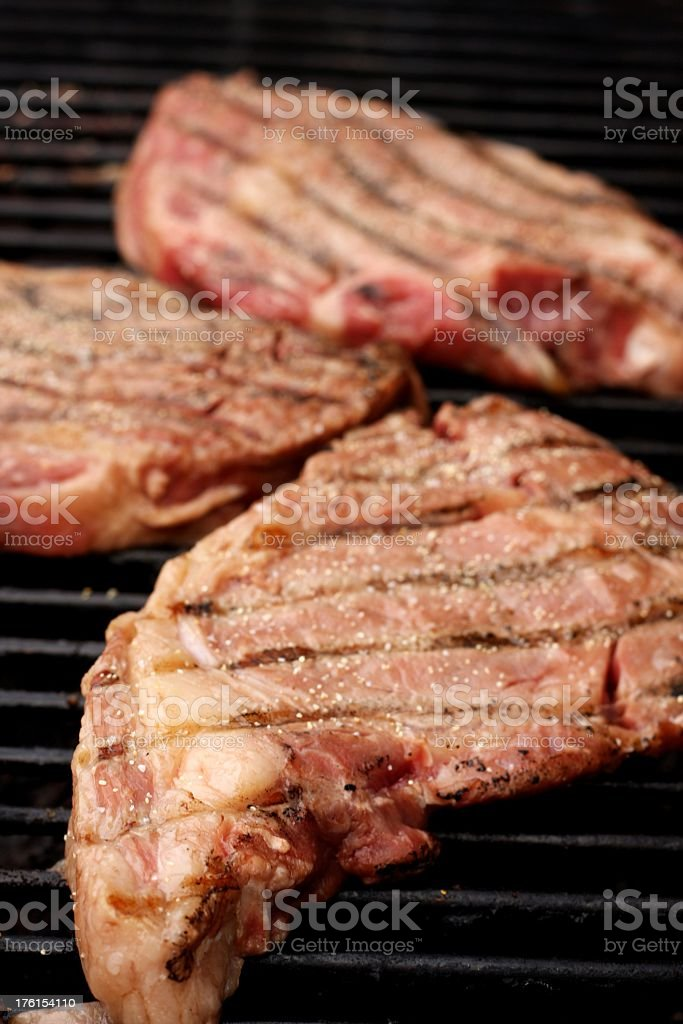 Ribeyes On The Grill royalty-free stock photo