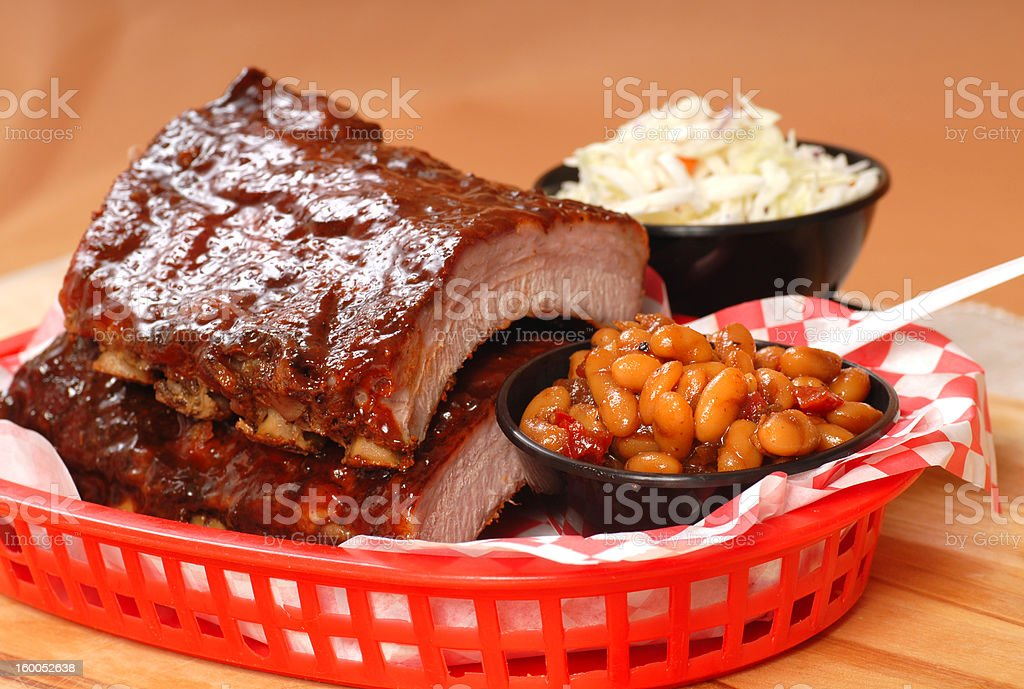 BBQ Ribs with beans and cole slaw stock photo
