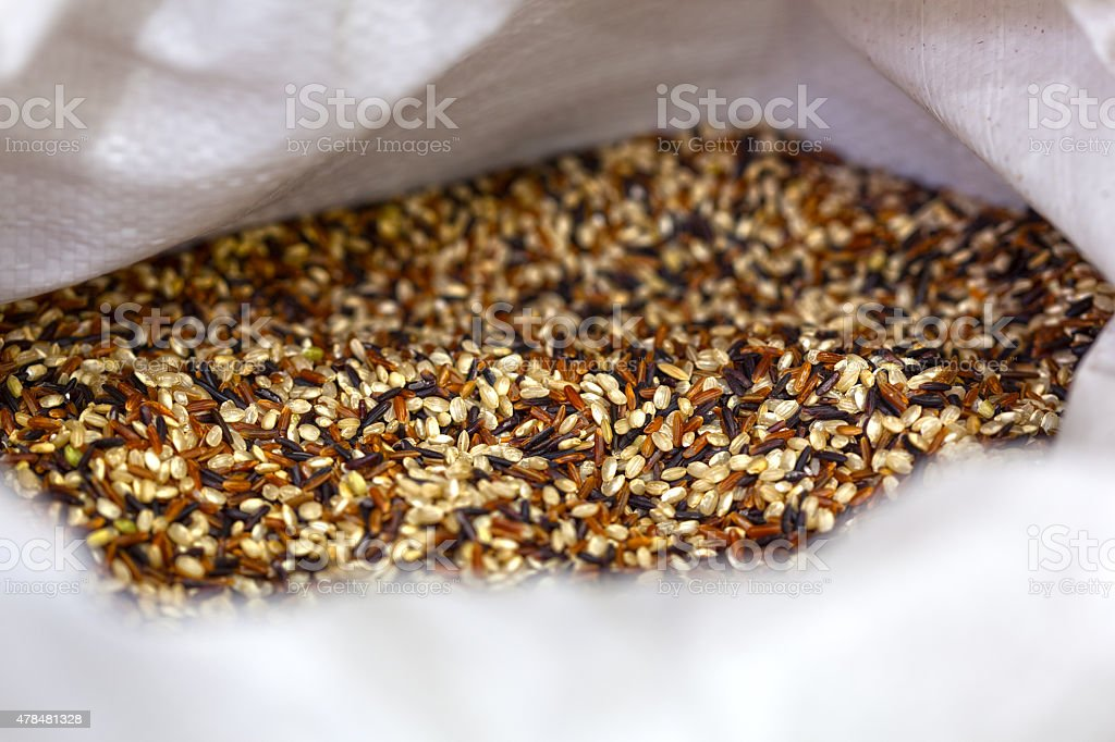 Rice allsorts in sack. Food background stock photo