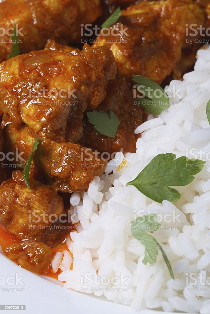 Rice and chunks of chicken curry macro vertical stock photo