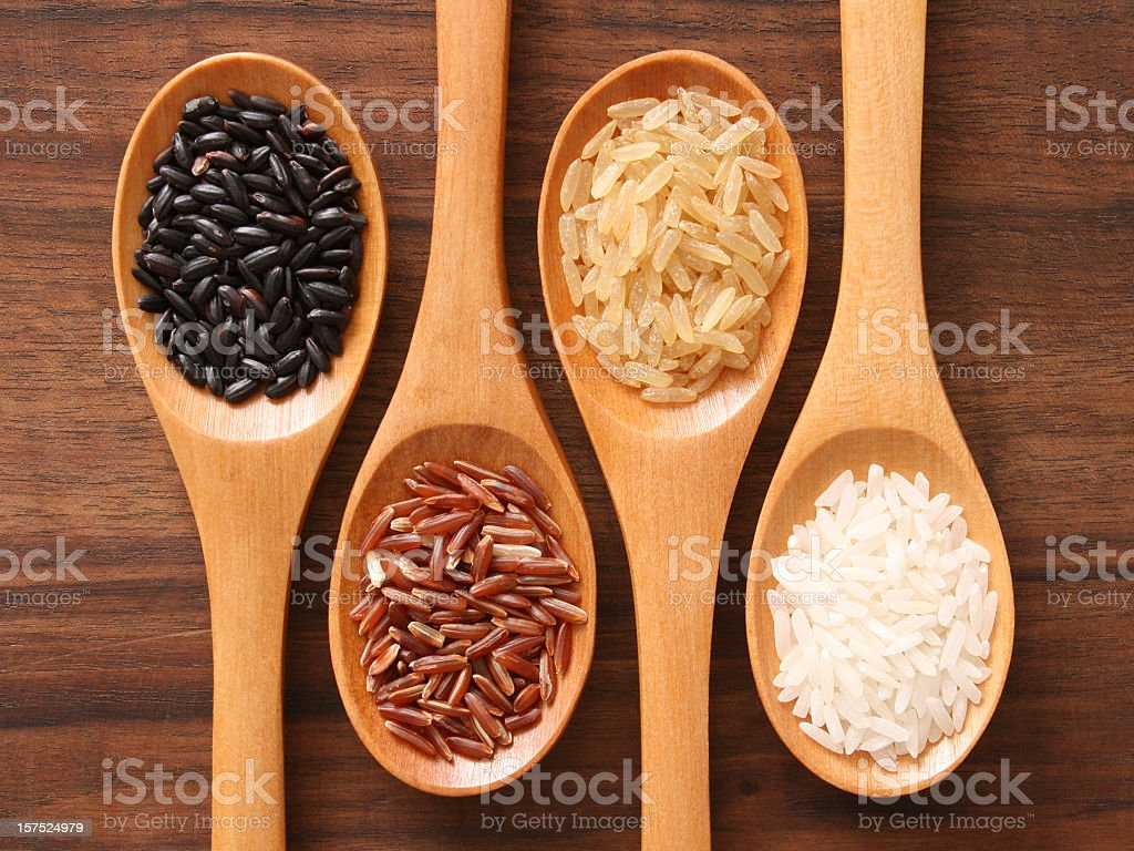 Rice and spoons stock photo