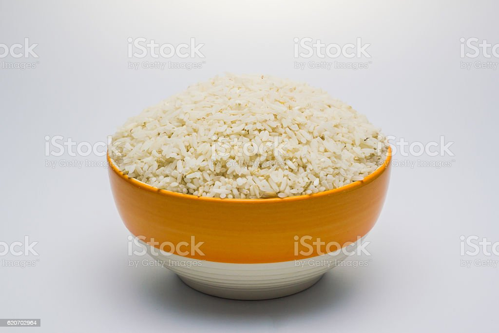 Rice be imperfect in the bowl on white background. stock photo