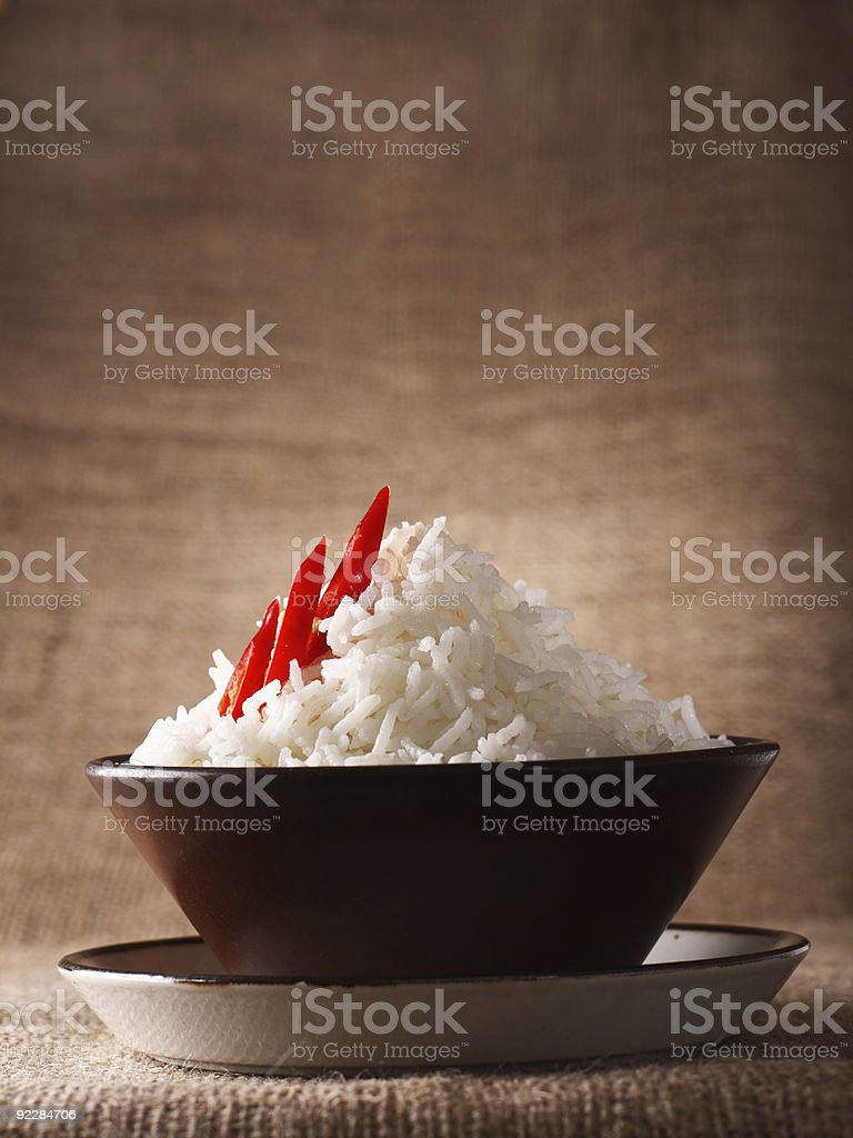 rice bowl with red hot chillies on rustic background royalty-free stock photo