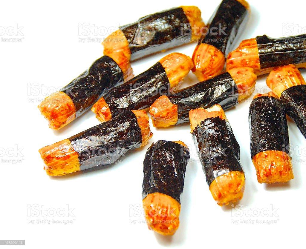 Rice cracker wrapped nori stock photo