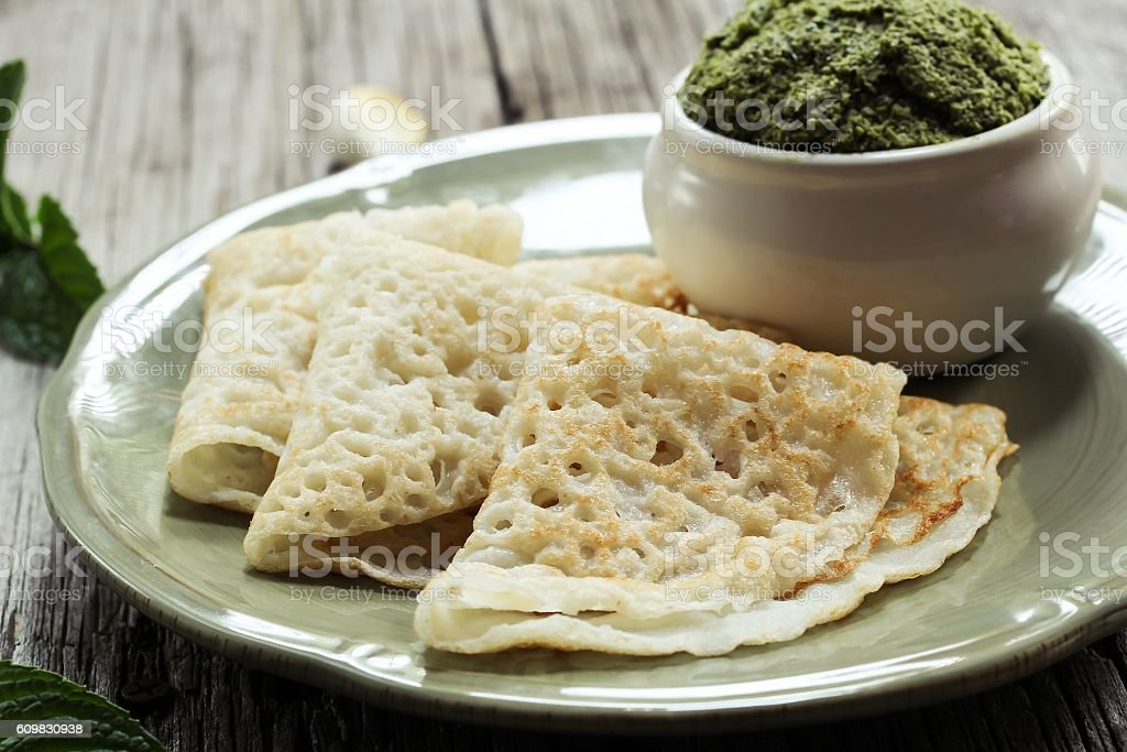 Rice Crepes / Rice dosa with mint chutney, selective focus stock photo
