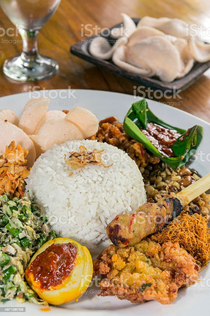 Rice dish with vegetables and chicken stock photo