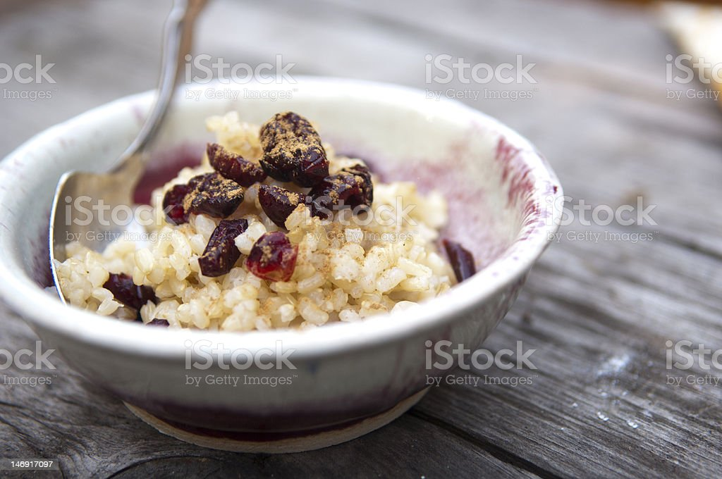 Rice dried fruit and cinnamon on rustic table stock photo