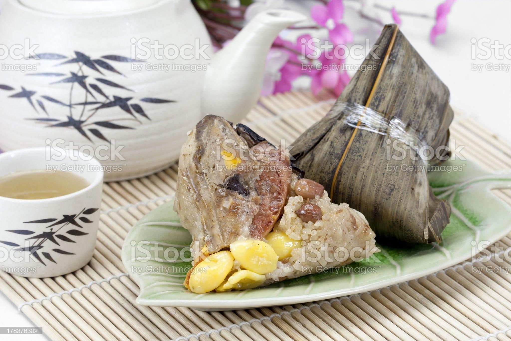 Rice dumplings or  zongzi with tea royalty-free stock photo