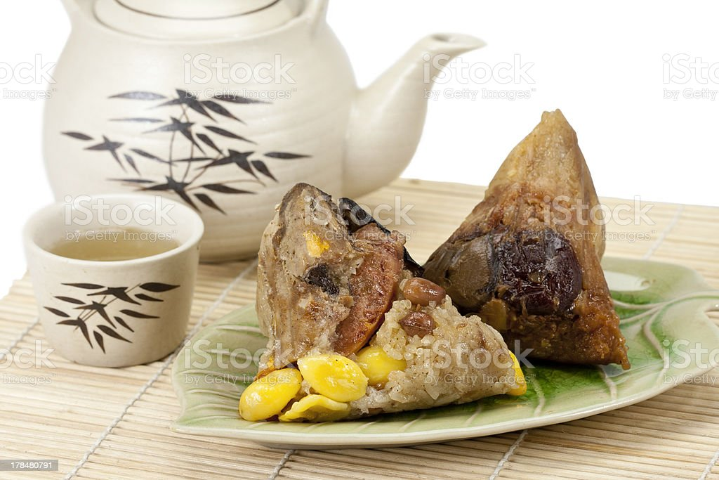 Rice dumplings or zongzi with tea stock photo