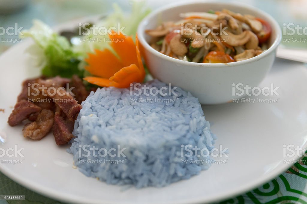 rice, fried pork and papaya salad or somtum stock photo