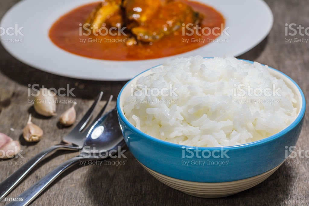 Rice in a bowl on table stock photo