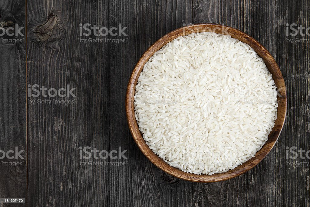 Rice in a wooden bowl royalty-free stock photo