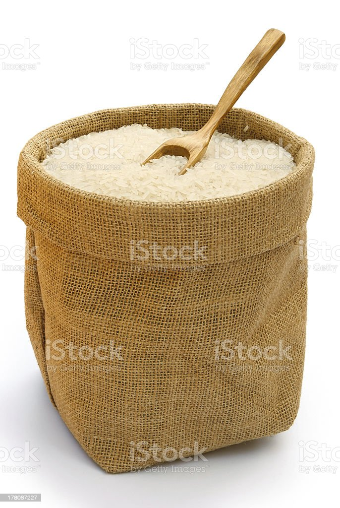 rice in gunny with a wooden spoon royalty-free stock photo
