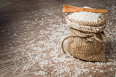 Rice in the burlap bag. Healthy eating and lifestyle.