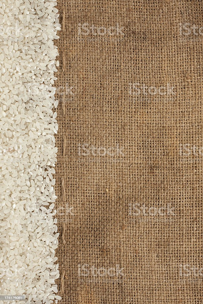 Rice lying on sackcloth royalty-free stock photo