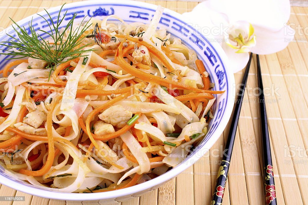 Rice noodle with chicken meat, chopsticks and orchid royalty-free stock photo