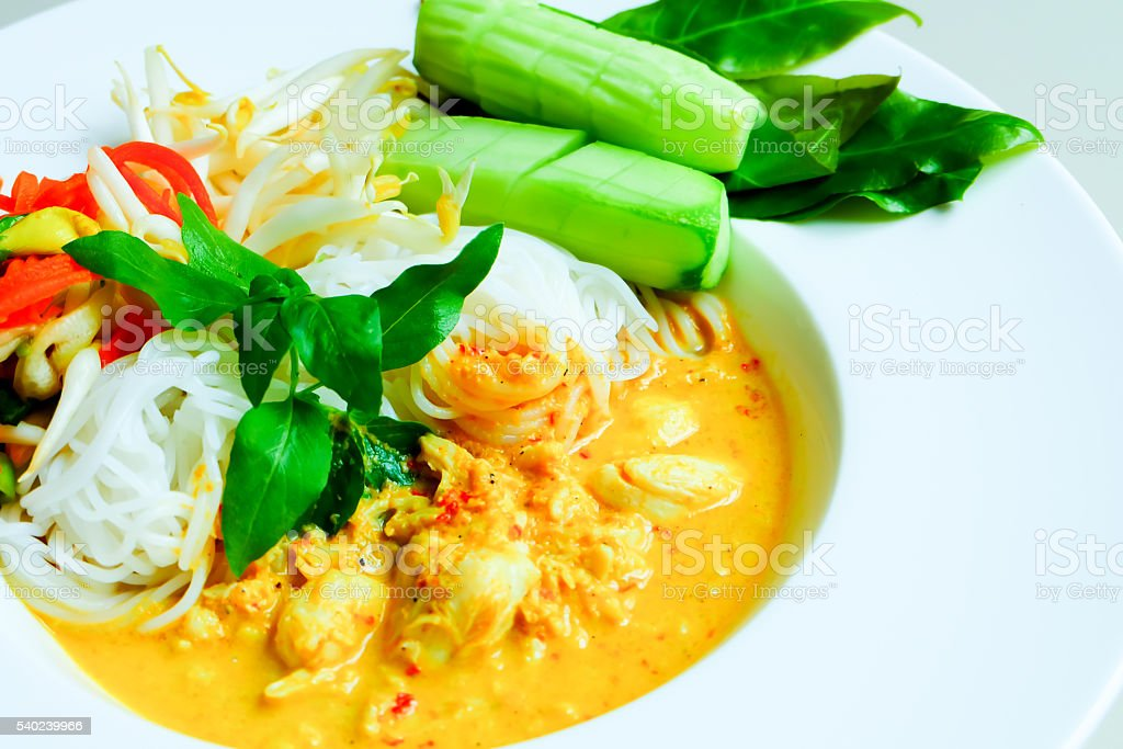 rice noodles in fish curry sauce with vegetables stock photo