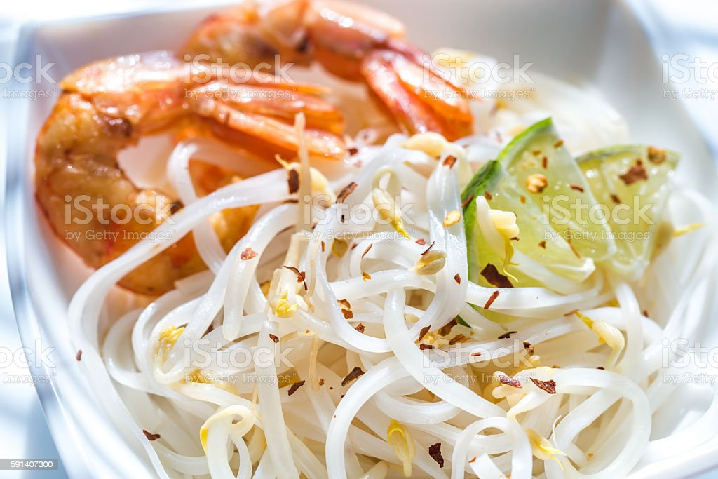 Rice noodles with shrimps and bean sprouts stock photo