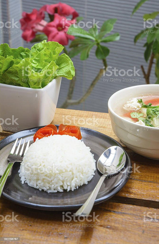 rice on dish and vegetable in cup stock photo