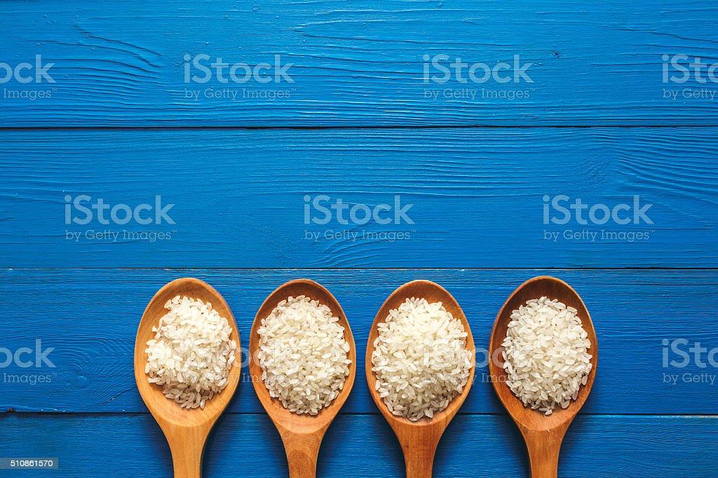 Rice on wooden spoon stock photo