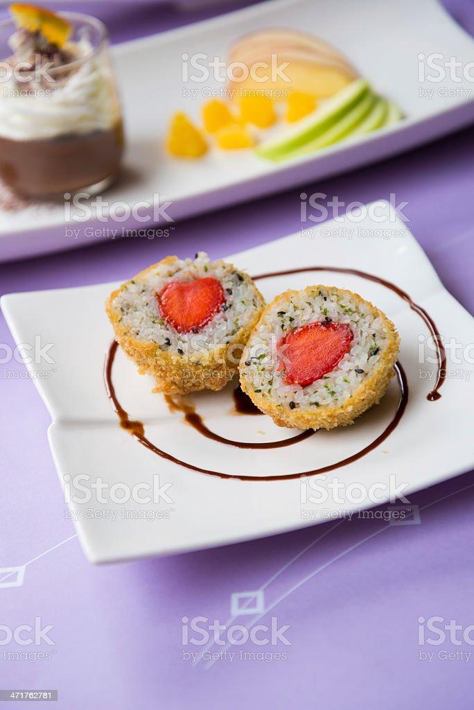 Rice onigiri strawberry stuffed , half cut royalty-free stock photo