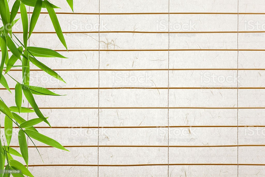 rice paper background with bamboo leaves royalty-free stock photo