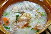 rice porridge with pork sausage topping egg on bowl
