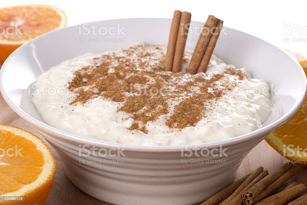 Rice pudding in a bowl topped with cinnamon stock photo