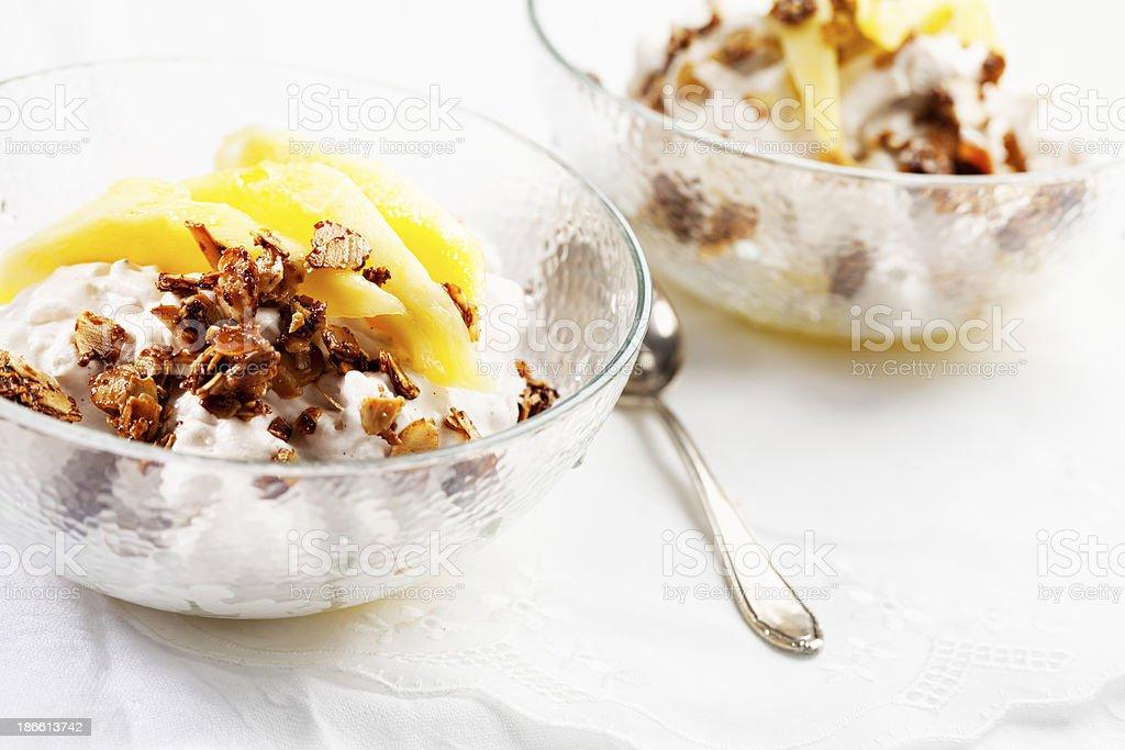 rice pudding mango and roast almonds stock photo