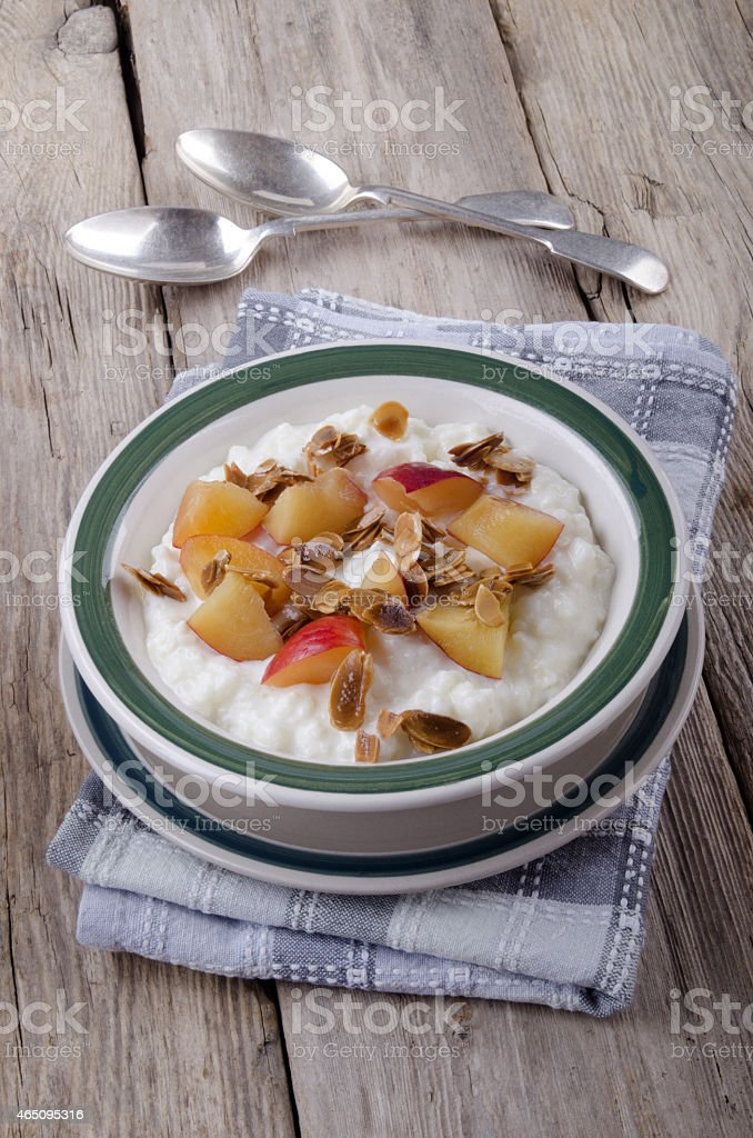 rice pudding with nectarines and roasted almond sliver stock photo