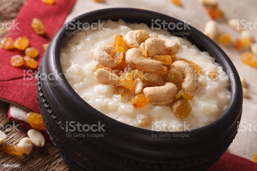 rice pudding with nuts and raisins in a bowl close-up stock photo
