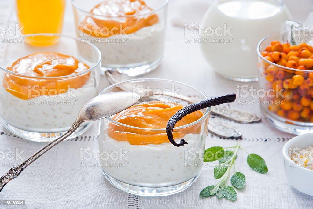 Rice pudding with sea buckthorn custard stock photo