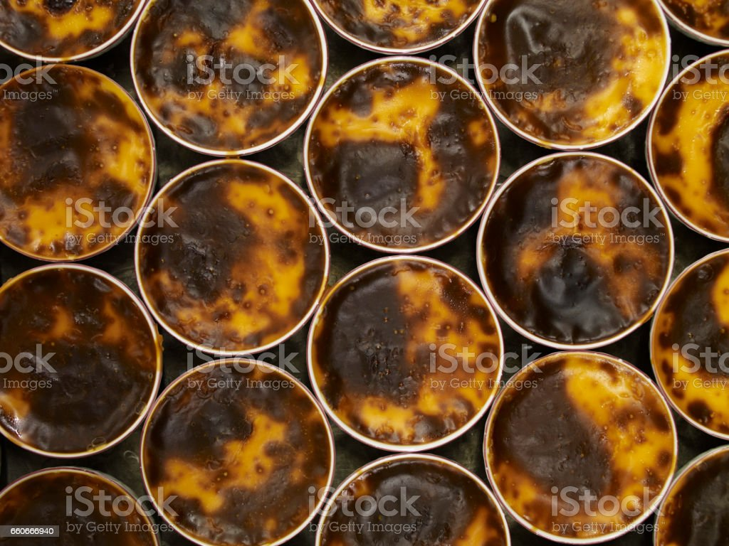 rice puddings in an oven stock photo