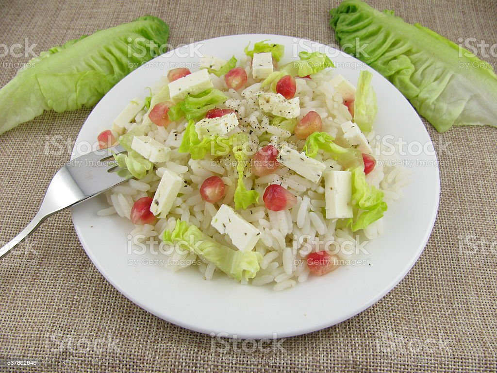 Rice salad with feta cheese stock photo