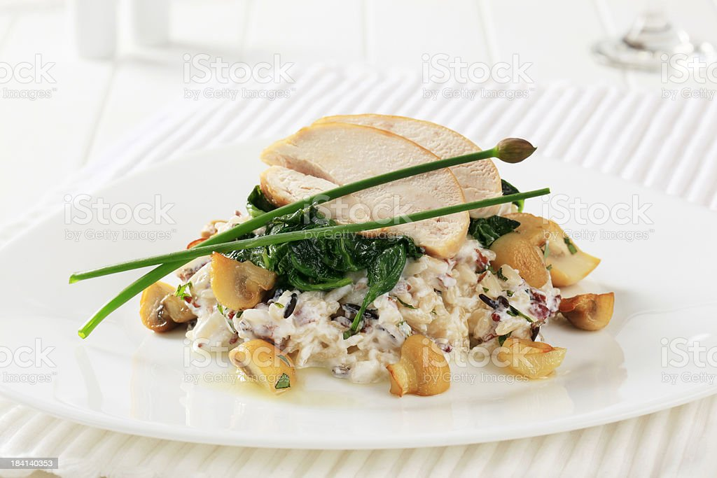 Rice salad with roasted mushrooms stock photo
