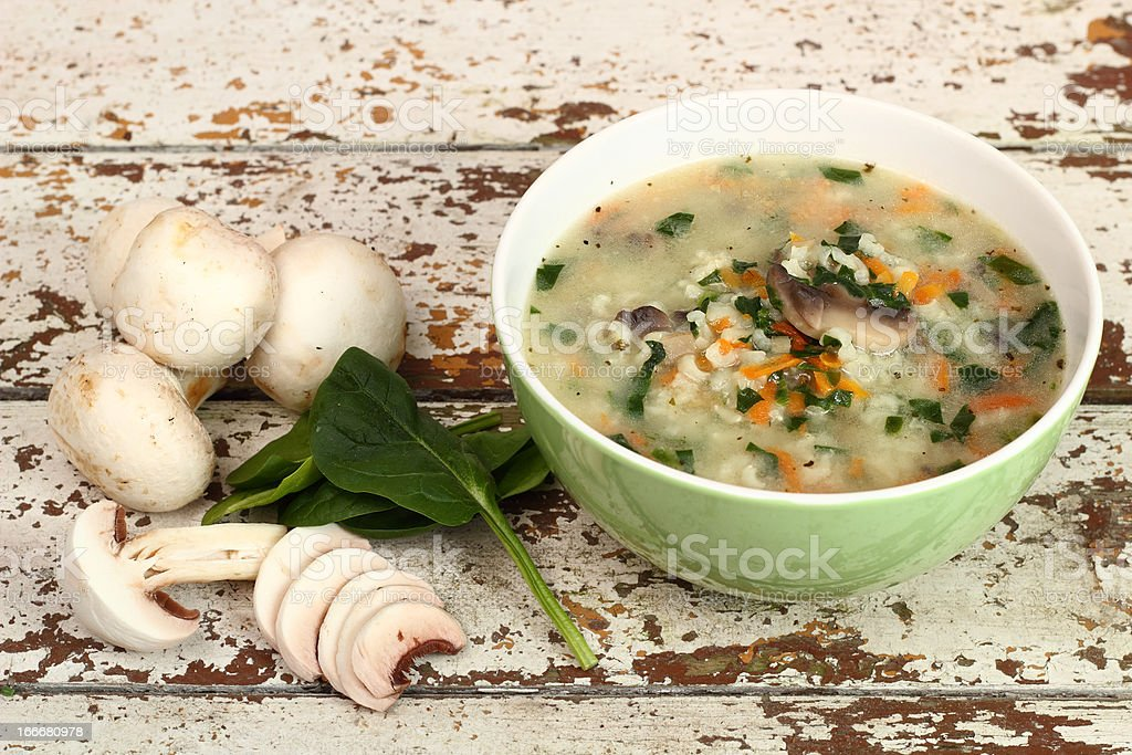 Rice Soup with Mushrooms and Spinach stock photo