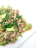 Rice topped with stir fried minced pork and basil,
