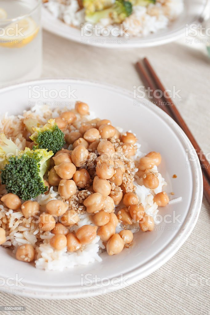 Rice with chickpeas and broccoli stock photo