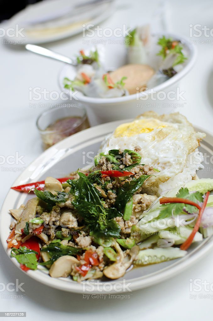 Rice with fried pork and basil leaves royalty-free stock photo