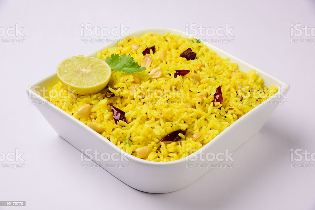 rice with lemon, curry leaf, red chilly in the bowl stock photo