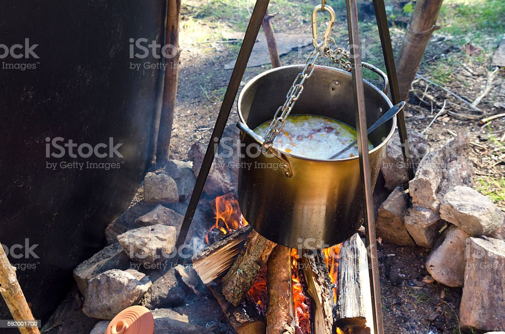 Rice with meat on a campfire stock photo