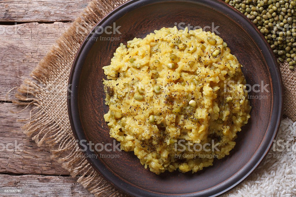 Rice with mung bean and spices close-up top view stock photo