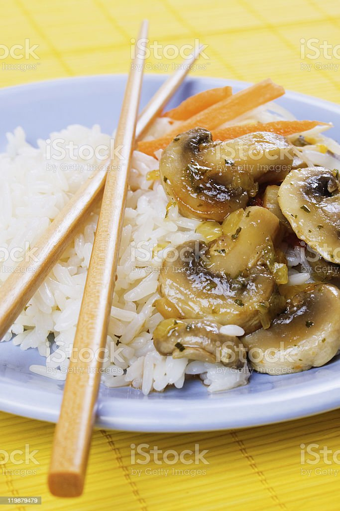 Rice with mushrooms and vegetables stock photo