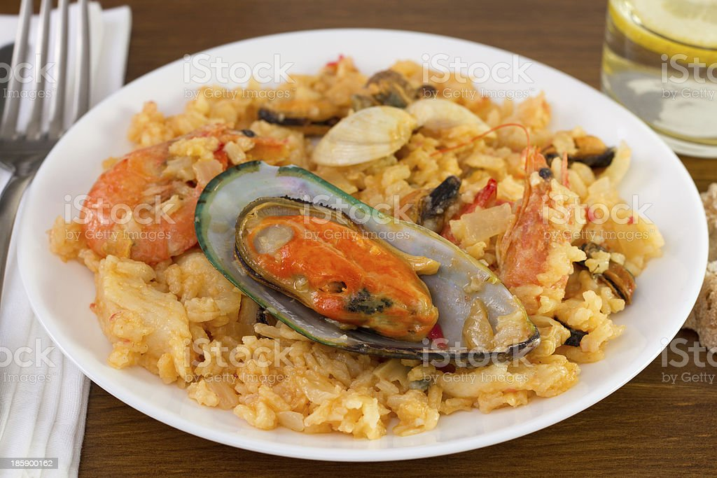 rice with mussels and shrimps on the plate royalty-free stock photo