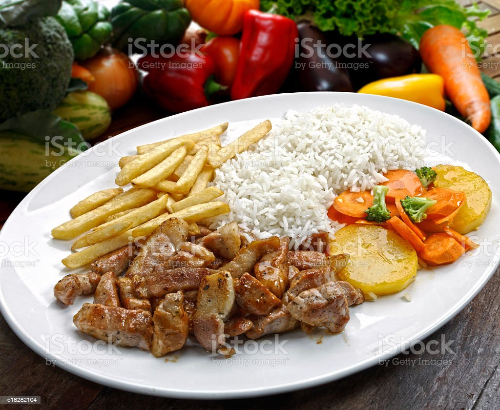 Rice with potatoes and meat. stock photo