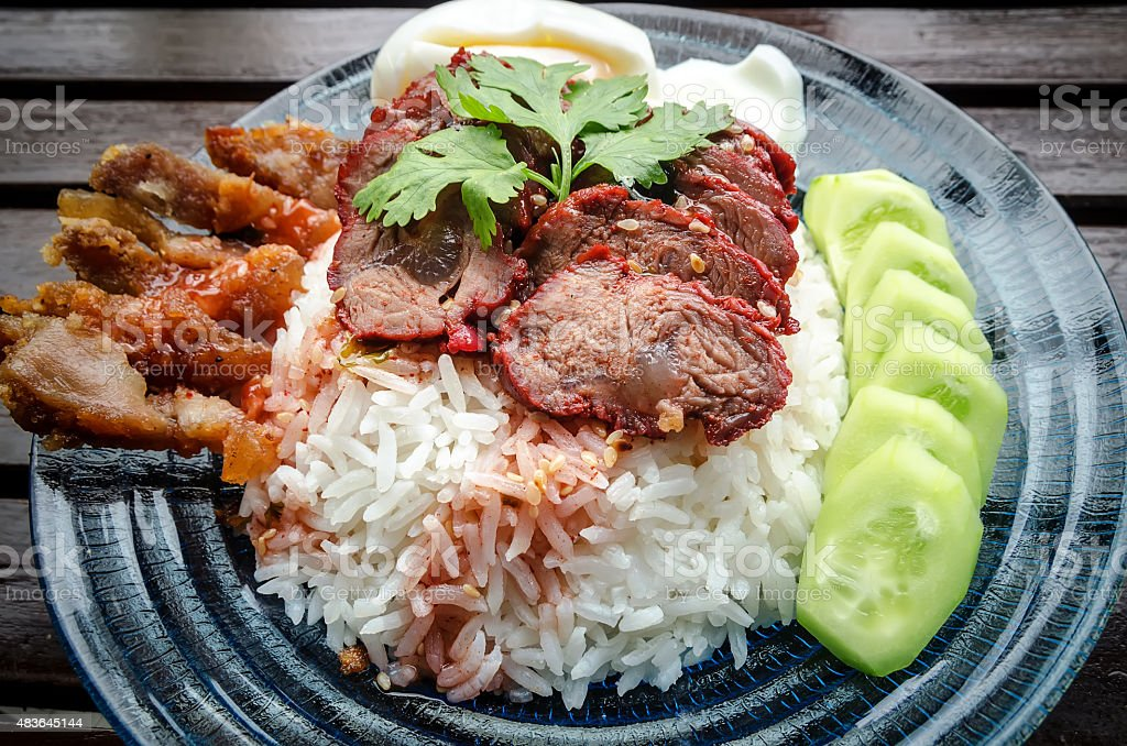 Rice with roasted pork vintage style. stock photo