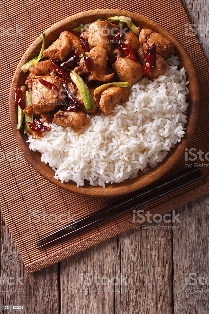 Rice with spicy kung pao chicken. Vertical top view stock photo