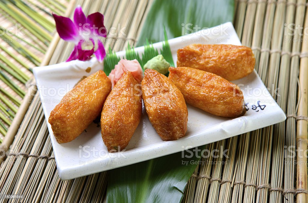 Rice wrapped in a fried tofu bag royalty-free stock photo